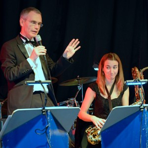 Band leader Les Bruce calls the pieces from the saxophone desk.