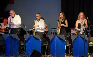 The sax section plays a group 'solo'.
